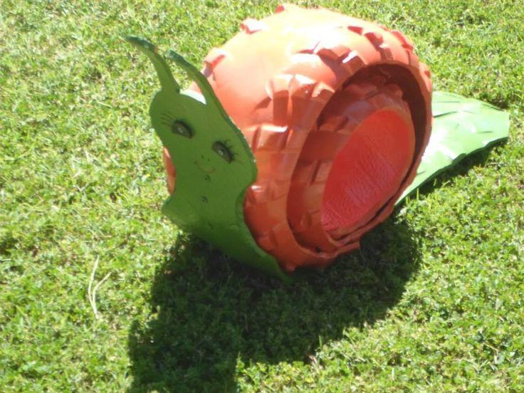 Adorno para jardin caracol hecho con llanta macetas for Caracol de jardin alimentacion