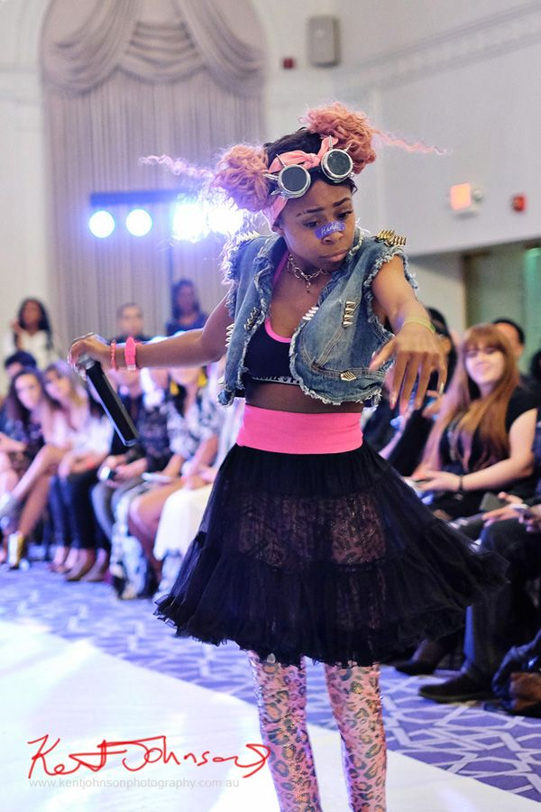 Kandi in pink black and blue with high energy dance moves. King Imprint & Kandi Reign Dance It Up LIVE at NYFW - Photographed by Kent Johnson for Street Fashion Sydney.