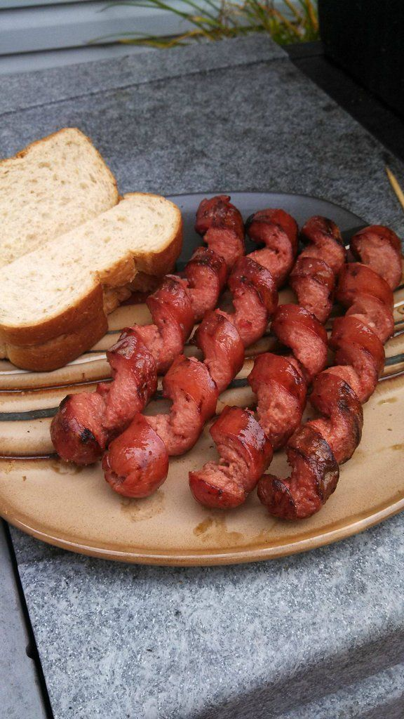 The far superior way to grill a hot dog is by spiraling it first, that way you get a larger surface area. Not only do they cook faster, but ...