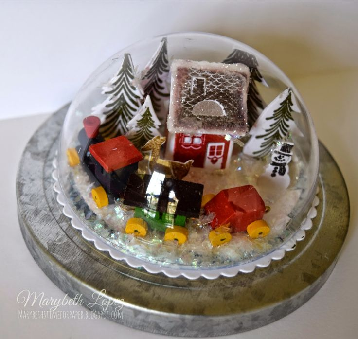 I made this snow globe for my grandson Jacob, because he loves trains .