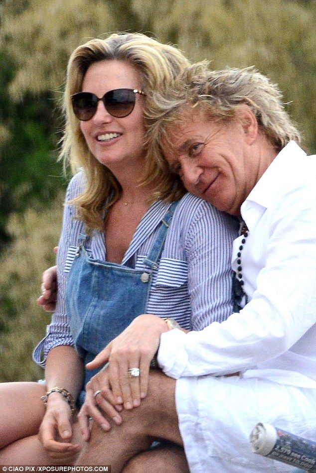 Lucky in love: On Thursday rock star Rod Stewart and his model wife Penny Lancaster snuggled and caressed during their family holiday in Venice, Italy