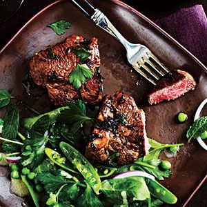 Marinated Lamb Chops--1/4 cup finely chopped fresh cilantro  2 tablespoons finely chopped fresh flat-leaf parsley  2 tablespoons minced onion $  2 tablespoons fresh lemon juice  1 tablespoon extra-virgin olive oil $  3/4 teaspoon smoked paprika  1/2 teaspoon ground coriander  2 garlic cloves, minced  8 (4-ounce) lamb loin chops, trimmed  Cooking spray  1/4 teaspoon salt  1/4 teaspoon freshly ground black pepper