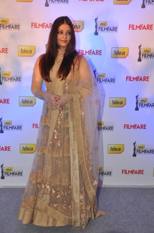 Aishwarya Rai Bachchan in a gold and beige anarkali by Sabyasachi via IndianWeddingSite.com
