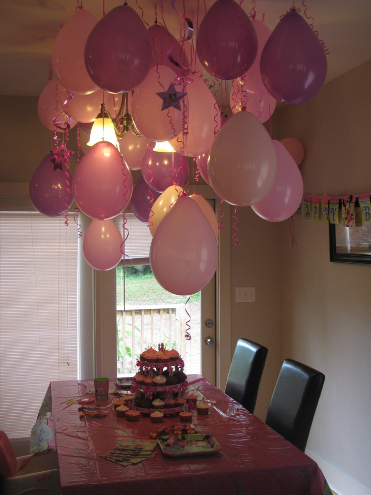 Balloon decorations for my daughter's Minnie Mouse Birthday Party. Hung from ceiling with tacs with extra long ribbon for a streamer effect. Looks over the top without alot of cost.
