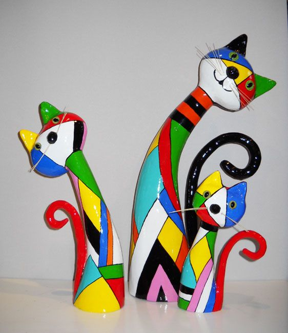 Beautiful colorful papier mache cats.