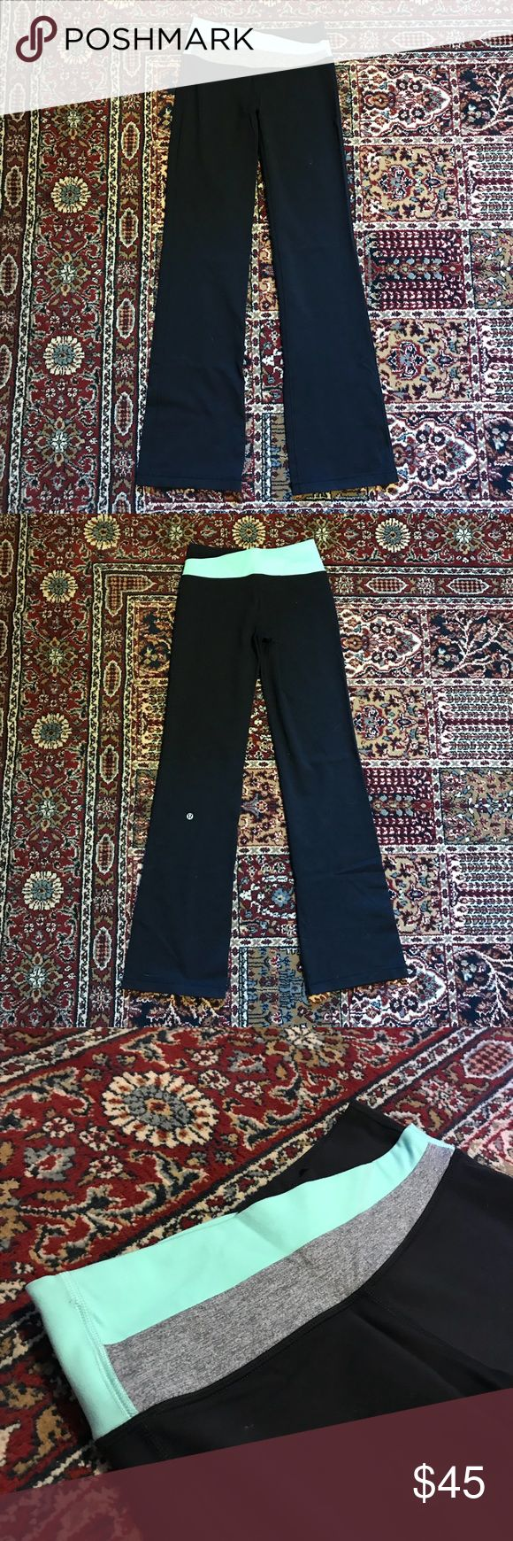 Lululemon Astro Pant Full-On Luon Yoga Size 4 Black lululemon astro yoga pants with light blue and gray accents at waist. Full-on Lyon material, four way stretch. Small pocket on back of waistband. Women's size 4 regular. In great condition, no pilling, worn a handful of times. lululemon athletica Pants Boot Cut & Flare