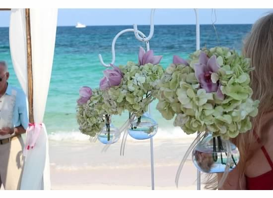 Ceremony Decor - Sheppard hooks with orchid arrangements in glass vase
