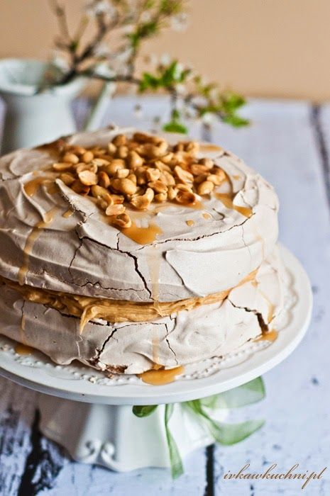 Pavlova with peanut butter, caramel sauce & roasted peanuts