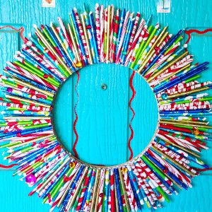 COOL Darling Wrapping Paper Wreath tutorial | FaveCrafts.com