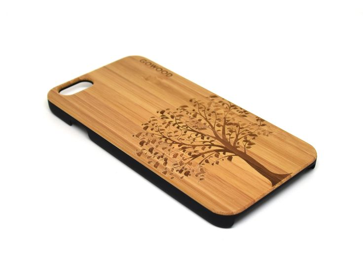iPhone 6 and iPhone 6S wood case with polycarbonate sides with a beautiful engraved tree. Resistant, strong and stylish. #iPhone #iPhone6 #case #wood #bamboo #iPhone6S
