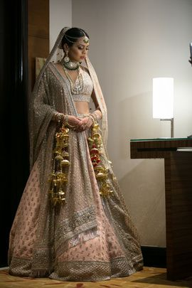 Bridal Lehengas - Ankit & Kanika wedding story | WedMeGood | Bride in a Soft Peach Lehenga with SIlver Border and Silver Sequinned Dupatta  #wedmegood #indianbride #indianwedding #bridal #lehenga #silver #pink #gold #kaleere #weddinglehenga