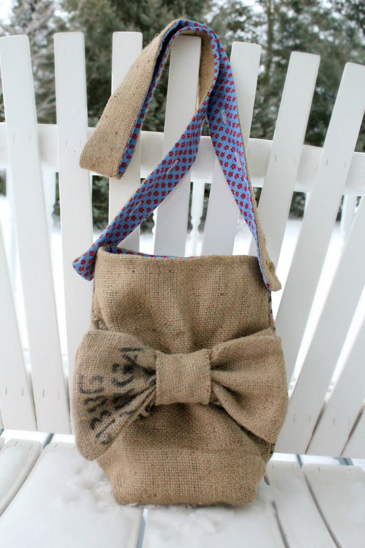 burlap purse with bow adjustable strap coffee bag fully lined with vintage blue and red flower print. These go fast!