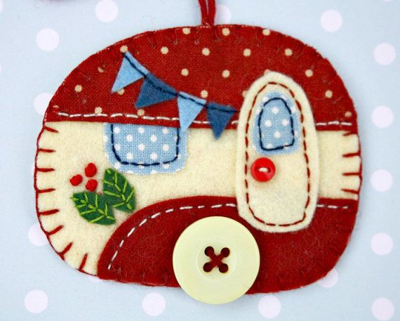 CHRISTMAS IN JULY! FREE SHIPPING THROUGHOUT JULY  Vintage caravan trailer hanging ornament, handmade from felt and decorated with fabric scraps. With tiny felt bunting and buttons for the wheel and door knob. Available in vintage red and cream, or vintage blue and cream. Blanket stitched edges and a cotton loop for hanging.  The ornament is flat in shape, with a plain felt back. Size approx 3 x 2.5 inches / 7.5 x 6.5 cm  A perfect finishing touch for a little caravan, or the Christmas tree.