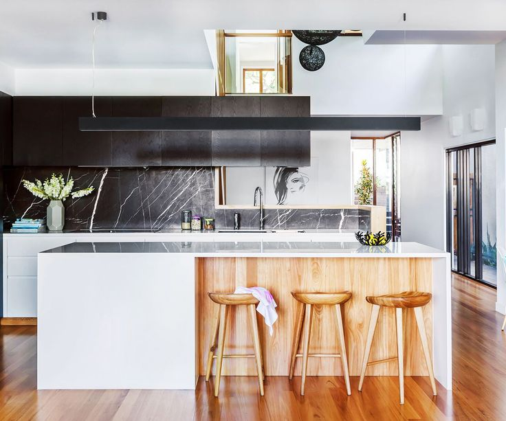 """In the kitchen, blackbutt timber and richly veined stone add richness to a simple layout. **Joinery** by [GW & DC Wathen](http://www.wathen.com.au/contact
