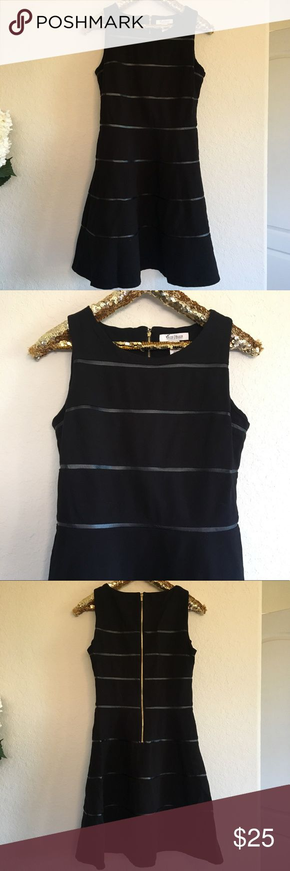 White House Black Market Striped Leather Dress This White House Black Market dress is in amazing condition and is perfect for the fall and winter season! The fit-and-flare style is so stylish and looks great on all body shapes!  🚭 From a smoke-free home ❌ No trades or off PoshMark sales 🛍 Bundles welcome and encouraged 👌🏻 Reasonable offers welcome ⚡️ Same/next day shipping 🌬 All items are steamed before shipping White House Black Market Dresses