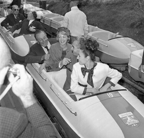 Walt in Disneyland: The Matterhorn with the Shah of Iran and Empress Farah. 25th April 1962.... loving the security guards in the bobsled behind them!