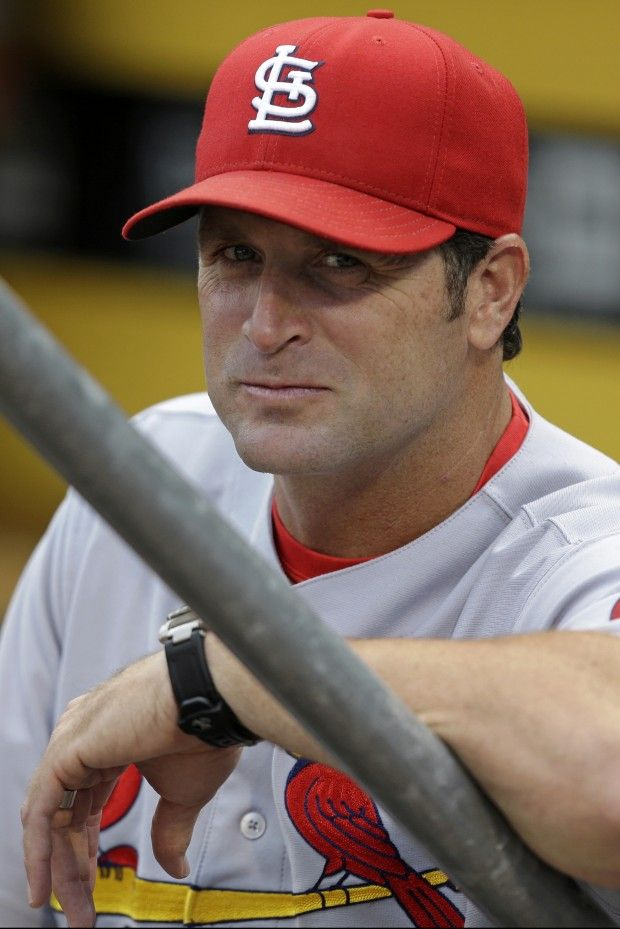 St. Louis Cardinals manager Mike Matheny stands in the dugout before the Cardinals' baseball game against the Pittsburgh Pirates in Pittsburgh on Thursday, Aug. 1, 2013. The Cardinals won 13-0. (AP Photo/Gene J. Puskar)