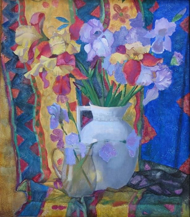Irises in the white pitcher.