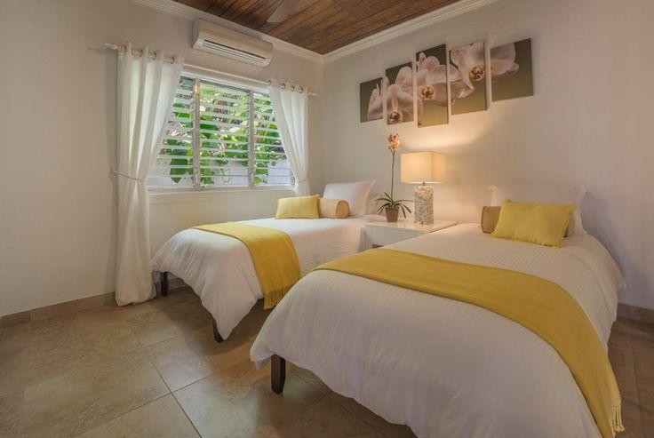 2nd bedroom: new ceiling, tiles, bedding, ceiling fan, lights, artwork, and fresh coat of paint! #saba #visitsaba #julianashotel #remodel #renovation #makeover #orchid #orchidcottage