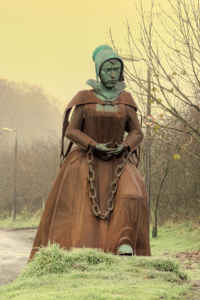 "Alice Nutter of Roughlee, One of twelve [Pendle witches] marched in chains from the pendle area to Lancaster. One of eleven tried at Lancaster Casle and one of ten hanged. The crime ""witchcraft"""