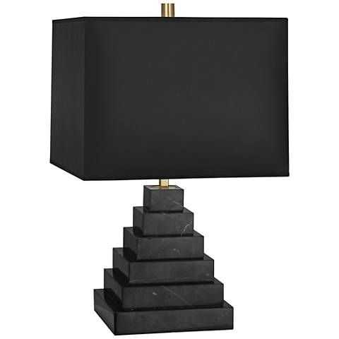 Bring an elegant detail to any decor in the form of this eye-catching contemporary tapered table lamp.