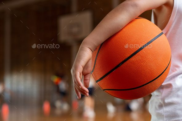 Mixed Race Schoolboy With A Basketball Under His Arm Standing In Basketball Court At School Youth Sports Sports Sports Psychology