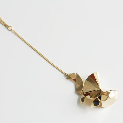 UNFOLD by Uli Budde and  A.E. Köchert, based on the shape of a brilliant-cut diamond.
