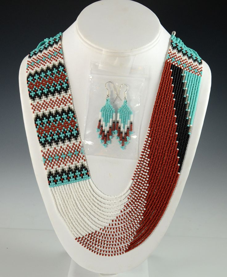 "-- INQUIRE -- ITEM NUMBER: NEC8925 ARTIST: Rena Charles TRIBE: Navajo DIMENSIONS: Measures 32"" long and 1-1/2"" Wide MORE DETAILS: Eye-catching Navajo Beade"