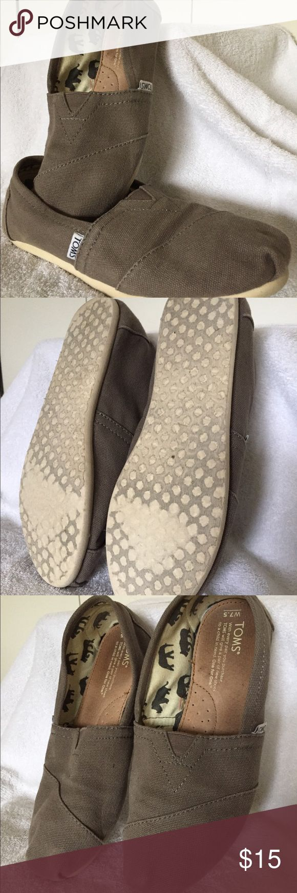 Classic gray TOMS. Classic gray TOMS were never worn barefoot—always worn with no-show socks.   Please note that the fabric near the toe is starting to thin (photographed) due to consistent wear. Toms Shoes Flats & Loafers