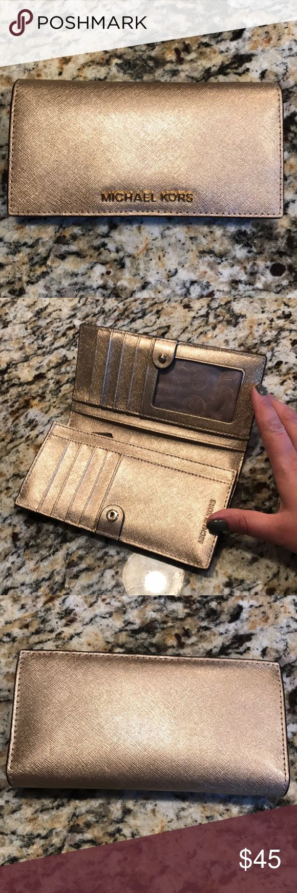 [Michael Kors] Jet Set Slim Wallet Michael Kors wallet - jet set slim in gold - gorgeous color! Used - but - No rips or stains, all stitching is intact! Hard to find one of these wallets in such good condition! Michael Kors Bags Wallets