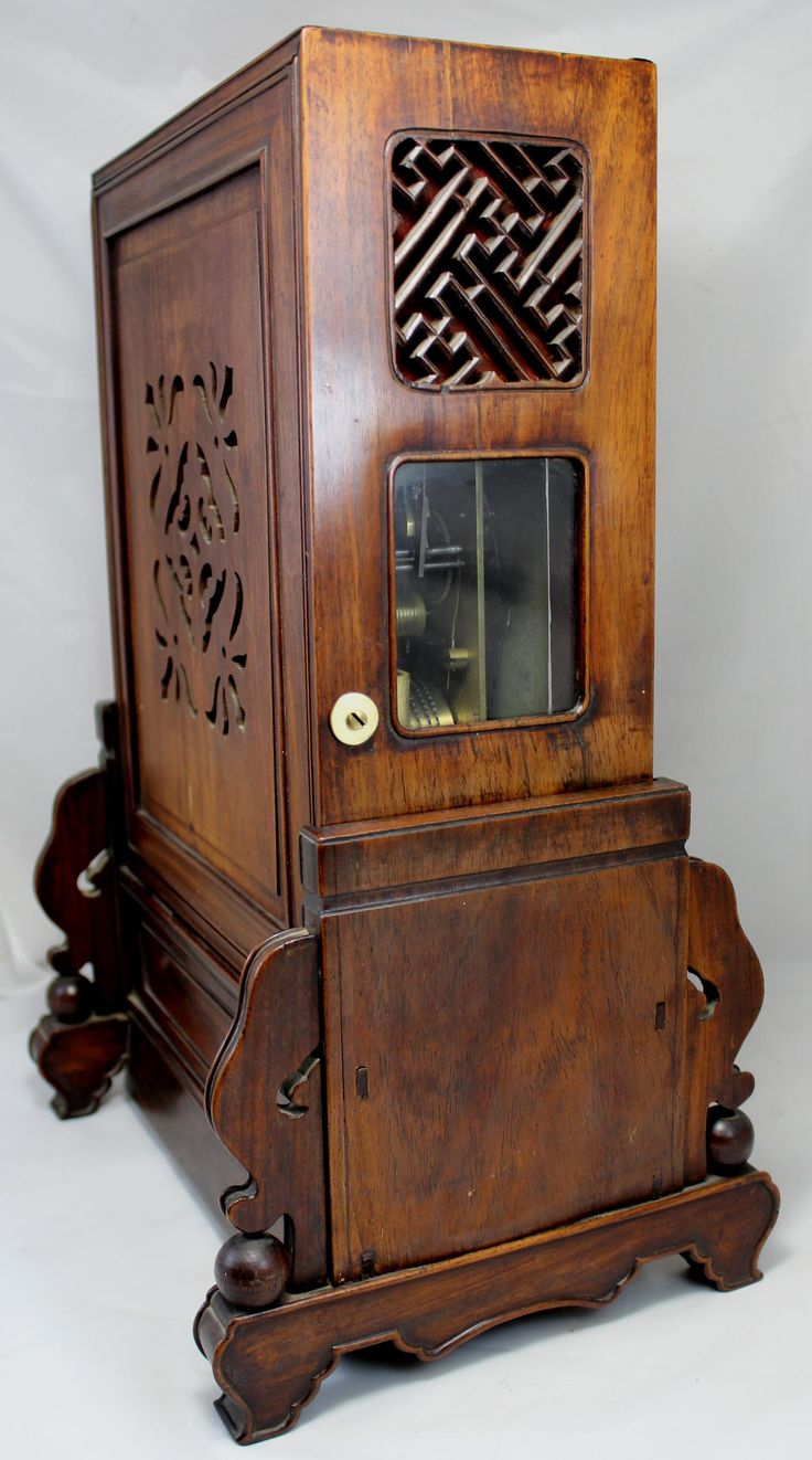 "This beautiful Chinese bracket clock with rosewood case and stand has a 6 ½"" diameter Roman numeral dial, pierced steel hands, sweep center seconds"