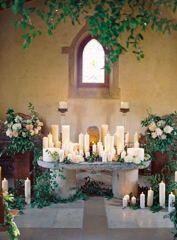 Candles and greenery for an earthy inspired wedding