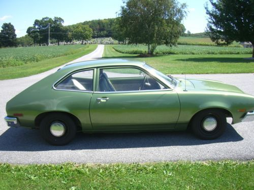 1972 Ford Pinto Hatchback...my first car (in light blue).