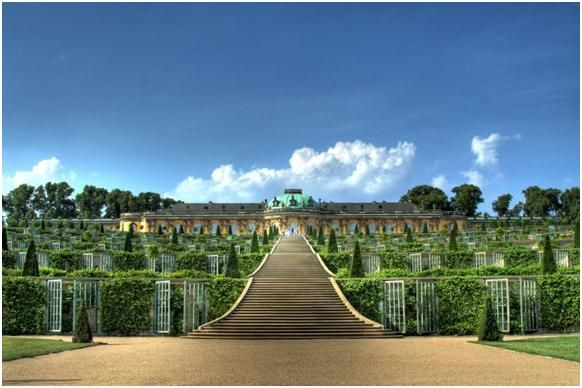Sans Souci Potsdam, Germany  Frederick the Great of Prussia built this splendid rococo palace as his summer place, where he could live without a care, sans souci. Busts of Roman emperors, decorative statues, and a Chinese tea house dot the lavish grounds.