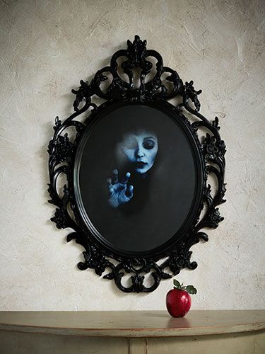 "DIY Chilling Mirror Image..""Reflective paint is this spectral mirror's secret. You can use any frame with glass""  Read more: DIY Halloween Decorations - Halloween Crafts and Do it Yourself Projects - Country Living Follow us: @Elizabeth Lockhart Lockhart Cassinos Living Magazine on Twitter 