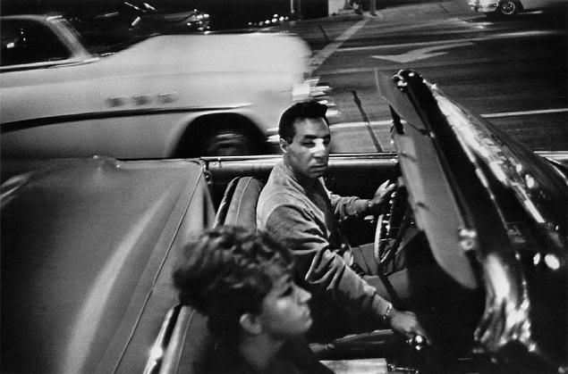 """Garry Winogrand Street Photography - Garry Winogrand shot a lot of photographs. To give you a sense of how much he shot, read this one account of him shooting on the streets from a former student that he had:  """"As we walked out of the building, he wrapped the Leica's leather strap around his hand, checked the light, quickly adjusted the shutter speed and f/stop. He looked ready to pounce. We stepped outside and he was on."""