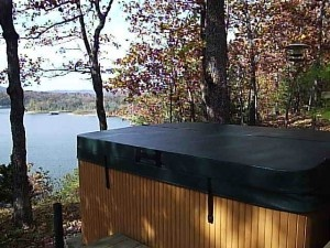 Great looking hot tub looking out over a lake with a beautiful hot tub cover from www.TheCoverGuy.com