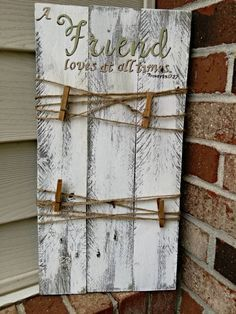 Etsy listing at https://www.etsy.com/listing/254226372/rustic-pallet-picture-display-with-twine