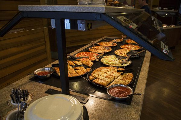 "Pizza Ranch touts its pizza and chicken options, seen here at the Fort Dodge location that opened last year. The company's vision statement is ""to glorify God by positively impacting the world."""
