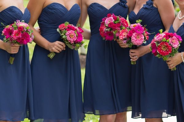 gorgeous bridesmaids in navy blue dresses and pink flowers