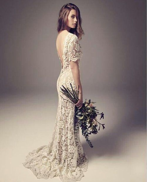 18 Romantic Bomemian Chic Summer Wedding Dresses for The Modern Boho Princess: Romantic long crochet boho chic summer wedding dress with low back and short sleeves