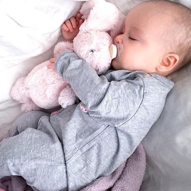 grey onesie + pink stuffed animal