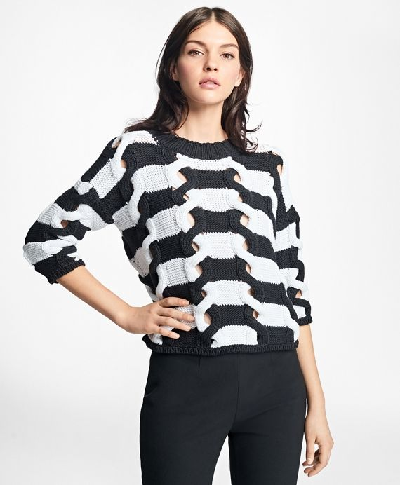 This dropped-shoulder sweater is crafted from cotton nylon yarns with twisted and open peekaboo cable knitting to create a chic broken-stripe finish.<br><br>Machine wash; imported.