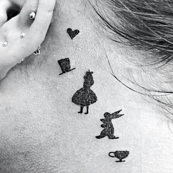 Minimalistic Alice in Wonderland tattoo. I would love this tattoo but in a different place