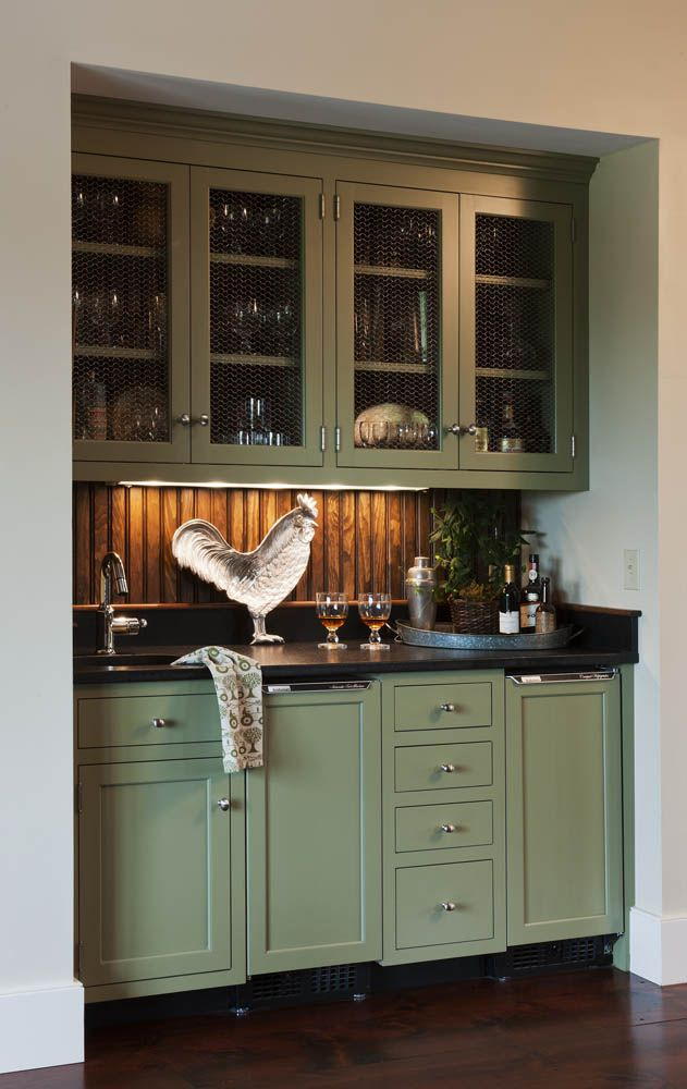 Custom appliance panels artfully conceal a beverage refrigerator and ice maker in this farmhouse wet bar.  #beadboard   Crown Point Gallery 104.8