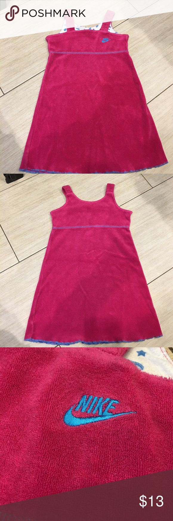 Girls size 6 NIKE dress/cover up Girls size 6 NIKE dress/cover up. It's like a really soft towel like stretch material 80% cotton 20% polyester Nike Other
