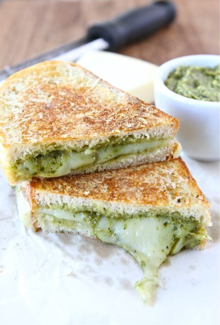 Parmesan Crusted Pesto Grilled Cheese Sandwich Recipe on twopeasandtheirpod.com The BEST grilled cheese sandwich!