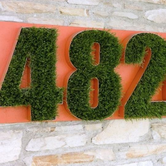 """""""Astro turf house numbers for a natural look"""" ... no, but great idea/inspiration, maybe with live moss insted?"""