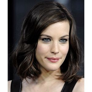 liv tyler dark brown wavy shoulder length bob hairstyle with side parting