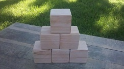 20 wood blocks measuring 2.5 x 2.5 inches. Unfinished or finished with natural child safe bees wax or coconut oil. Edges are either not sanded or sanded to round shape, whatever your preference might be. Wood type is high quality Douglas Fir.